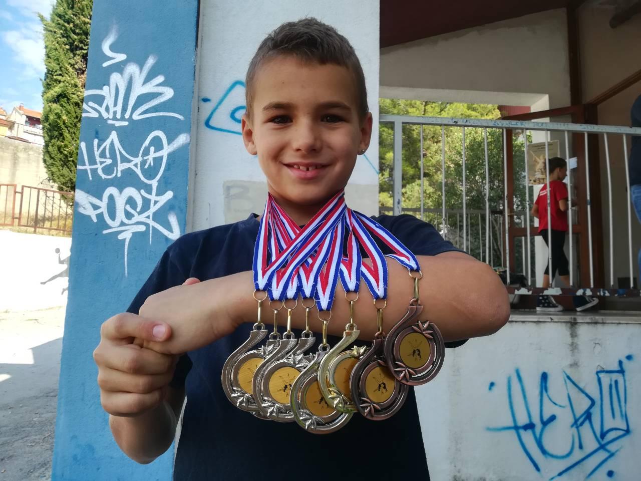 gk dispet medaljas